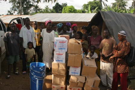 Gbebedu a town close to the Guinean border survivers receive donation after losing 19 to ebola