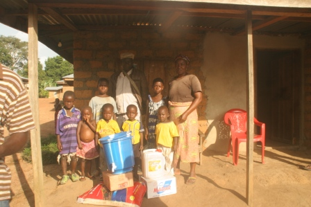 Kadiatu Balloh and family in Balloh quarter, Samodu - receive donation from SEFL  through Multi Services