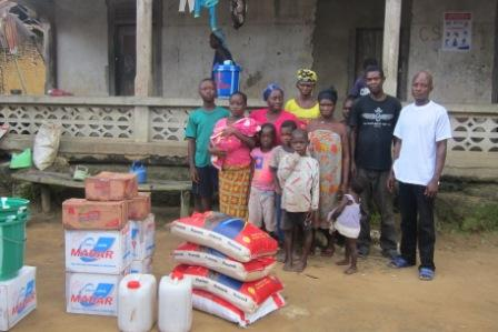 A family of 15 in Bo - a town at the border of Liberia and Sierra Leone receives aid from SEFL after losing 3 to ebola