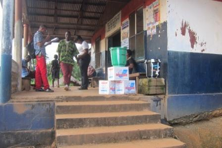 A  joint Security Check Point in Tiane, where general screening for ebola is conducted receive disinfectance from SEFL to help combat ebolaobserved by  County Health Team to avoid further spread