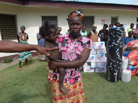 Felecial King (holding baby) lost all family members to ebola in Worhn