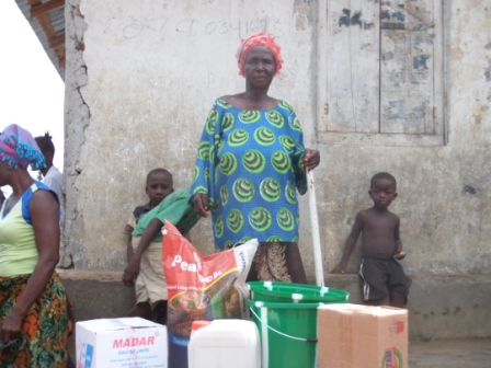 Hawa Swaray , an elderly woman in the Vai Town Community who lost two children to ebola receive donation