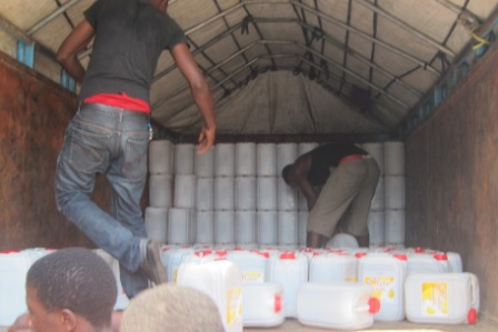 Loading one of the trucks with oil for Margibi
