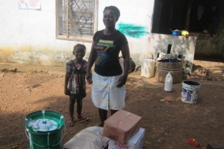 Sandoe Pinny, an Ebola widow in Up-Town community receives aid from SEFL