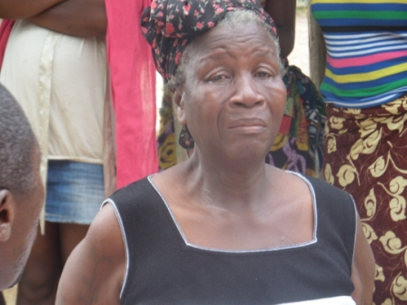 Madam Bendu Quey wept profusely upon receiving ration following the death of 53 years old son K Quey, who was bread winner and olny health worker in the area
