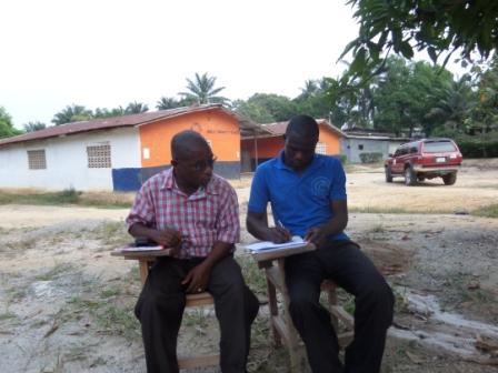 Benla Community School Principal- Mr. Joseph K. Kollie signing SEFL Scholarship contractual agreement