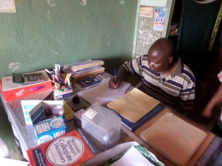 Calvary Community School Proprietor - Rev. Moses S. Maomou Signs contract
