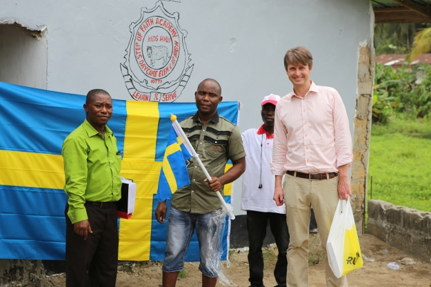 Handover of flag to the principal Emmanuel M. Nyantee